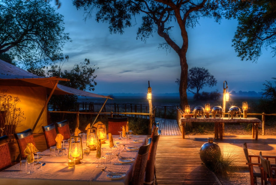 Dining al fresco at Kadizora Camp, North West Okavango